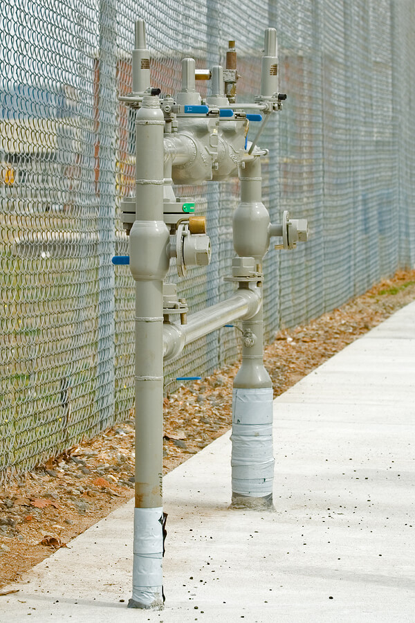 A photo of a back flow preventer used to regulate the direction of water flow.