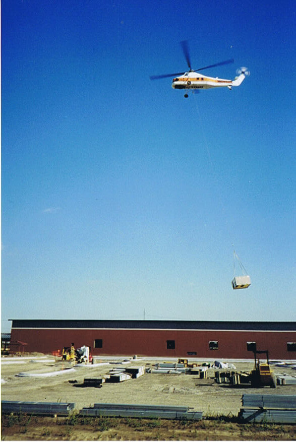 Roof top package air conditioning unit placed by helicoptor